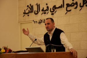 Photo of a Jordanian Pastor preaching in the face of Christian persecution.