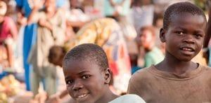 Central African Child in a market overcoming Christian persecution.