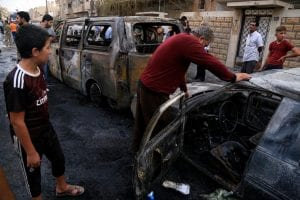 the results of a car bomb in Qamishli, Syria