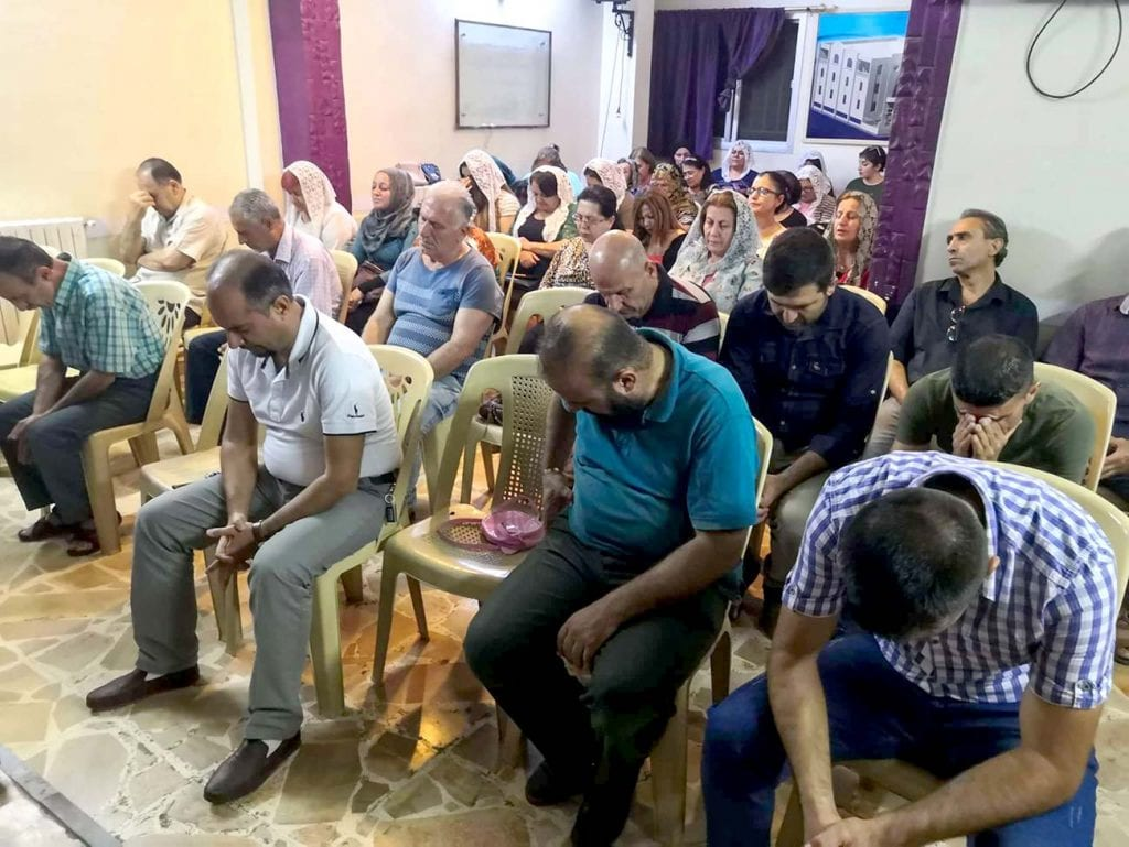 Christians pray for peace and relief in Qamishli, Syria.