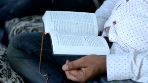 person reading an Arabic Bible
